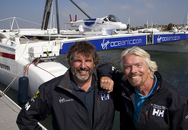 "Sir Richard Branson (r) of the Virgin Oceanic submarine along with Chris Welsh,-co-pilots of the just unveiled Virgin Oceanic submarine as it sits atop its ""mothership"", the ""Cheyenne"" catamaran, Tuesday April 5th in Newport Beach, CA. The submarine project is to explore the deepest points in the five oceans, to depths of 36,000+ and Sir Richard will make the descent in the Atlantic. Chris Welsh will undertake the other 4 explorations. The catamaran, was formerly owned by Steve Fossett who raced it around the world as ""Playstation""."